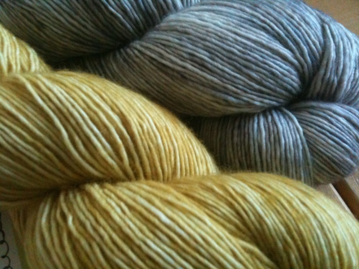yellow and grey yarn